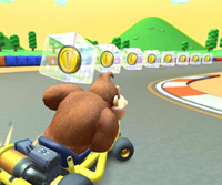 The icon of the Peach Cup challenge from the Tokyo Tour and the King Boo Cup challenge from the Super Mario Kart Tour in Mario Kart Tour