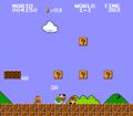 SMB Mario Kicking Green Shell into Goombas Screenshot.png