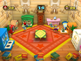 Wario bopping at Bowser Bop in Mario Party 4.