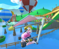 The icon of the Peach Cup challenge from the New York Tour and the Pink Gold Peach Cup challenge from the Mario vs. Luigi Tour in Mario Kart Tour.
