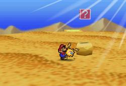 Image of Mario revealing a hidden? Block in Dry Dry Desert, in Paper Mario.