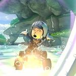 A female Mii performing a trick in Mario Kart 8