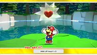MAX UP Heart +5 from Whispering Woods, revitalized from a Shriveled MAX UP Heart found in Scorching Sandpaper Desert, in Paper Mario: The Origami King
