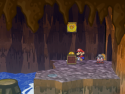 """Screenshot of Mario using his Hammer to reveal a hidden """"stepping stone"""" Coin? Block in Pirate's Grotto, in Paper Mario: The Thousand-Year Door."""