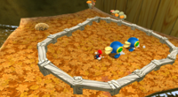 A screenshot of Cataquacks approching Mario at the Gold Leaf Galaxy.