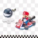 Mario mini-car with a Chain Chomp figurine from Super Nintendo World