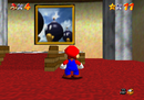 Mario facing the picture of Bob-omb Battlefield