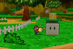 Image of Mario revealing a hidden? Block in Goomba Village, in Paper Mario.