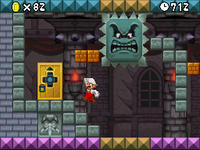 Mario Jumping to reach a door and avoid a Big Thwomp in the level World 8-Bowser Castle.