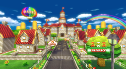 Mario Kart Wii: An overview of Mario Circuit, seeing the castle surrounded by houses as residence