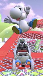 White Yoshi performing a trick.