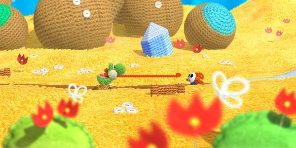 Banner for a Yoshi's Woolly World Play Nintendo opinion poll on which hand-knit yarn object to receive as a gift. Original filename: <tt>2x1-wooly_wolrd.0290fa9874e6c2e6db1c3f61b1e85eb024429302.jpg</tt>