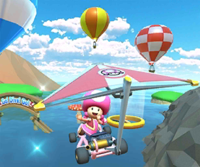 The icon of the Toadette Cup challenge from the Ice Tour and the Lakitu Cup challenge from the Summer Festival Tour in Mario Kart Tour