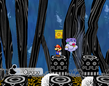 Mario next to the Shine Sprite in the room below the Super Boots area of the Great Tree.