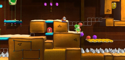 Perils of the Perplexing Pyramid from Yoshi's Woolly World.
