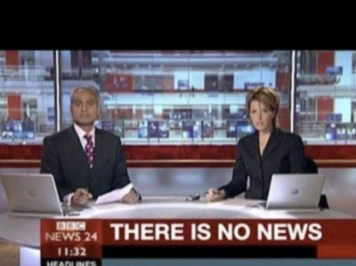 Image depicting two news anchors at a desk, with a headline at the bottom of the screen stating that there is no news.