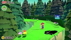 Mario in front of Not Bottomless Hole No. 12 of Whispering Woods in Paper Mario: The Origami King