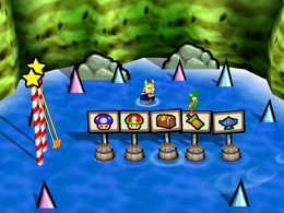 Swinging with Sharks: Yoshi jumping out to land one of the barrels that hold up a sign that has the desired item. From Mario Party 3.