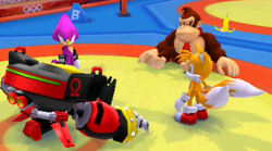 Omega collides with Donkey Kong while Espio and Tails look on