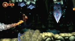 Donkey Kong flying to a large, falling crystal in the level Mole Patrol from Donkey Kong Country Returns