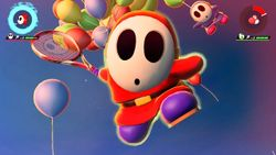 Shy Guy performing his Special Shot, the Balloon Assist