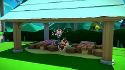 A Toad saved from being stuck under a stool in Paper Mario: The Origami King. The eighth hidden Toad in Whispering Woods.