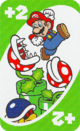 The Green Draw 2 card from the UNO Super Mario deck (featuring Mario, Piranha Plants, and a Buzzy Beetle)