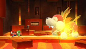 The Yoshis fighting a boss in Yoshi's Woolly World.
