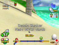 The ball in a beach bunker in Mario Golf: Toadstool Tour