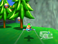 Tiptup finds a Golden Balloon behind the log path on Timber's Island in Diddy Kong Racing.