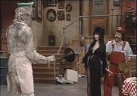 Mario and Elvira regard a mummified Luigi.