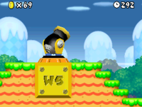 Mario about to be shot from the cannon in World 1.