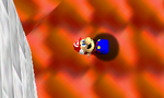 Mario lying sideways, on the ground (top) and during Wing Cap flight (bottom)