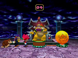 Wario trying to inflate the balloon in Balloon of Doom in Mario Party 4.