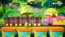 Yoshi fighting the Gator Train in the Yoshi's Crafted World boss level Gator Train Attacks!