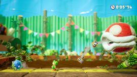 Yoshi fighting Spike the Piranha in the Yoshi's Crafted World boss level Spike the Piranha.