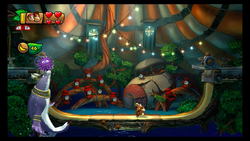 Pompy releasing a sea urchin at the Kongs in Big Top Bop boss level of Donkey Kong Country: Tropical Freeze