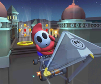 The icon of the King Boo Cup challenge from the Hammer Bro Tour and the Lakitu Cup challenge from the Summer Tour in Mario Kart Tour.