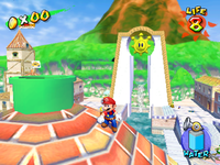 Mario stands next to an early version of Sirena Beach's pipe entrance (which is green rather than red.)