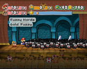 Mario and Goombella battling Fuzzy Horde in Shhwonk Fortress.