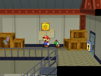 Mario next to the Shine Sprite on the second floor of Glitz Pit's storeroom in Paper Mario: The Thousand-Year Door.