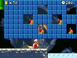 Fire Mario runs under several Spike Tops in a level in New Super Mario Bros.