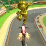 Gold Mario performing a trick.