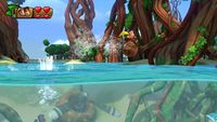 Donkey Kong skips the water with a Kong Roll and the help of Dixie Kong.