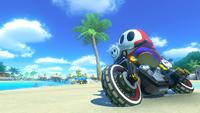 Shy Guy drives through the Retro Course, Cheep Cheep Beach, from Mario Kart 8