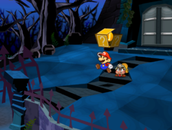 Screenshot of Mario revealing a hidden Coin? Block at the Creepy Steeple's front entrance, in Paper Mario: The Thousand-Year Door.