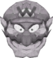 Wario using the Thwomp Candy.