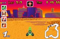 Yoshi racing on Choco Island 1 in Mario Kart: Super Circuit.
