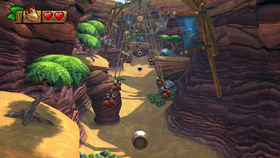 Donkey Kong prepares to launch himself between a series of swinging bombs in Cannon Canyon