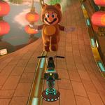 Tanooki Mario performs a trick.